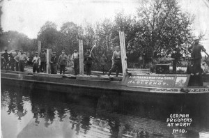210. German POWs unloading timber at Frimley Wharf